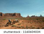 horseback riders on a trail in... | Shutterstock . vector #1160604034