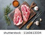 raw pork steaks with seasoning... | Shutterstock . vector #1160613334