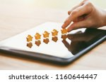 hand gives five stars rating as ...   Shutterstock . vector #1160644447