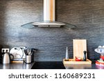 Stock photo modern clean interior of kitchen with cooking utensils tea pot or kettle cutting board coffee 1160689231