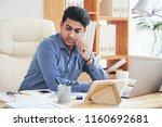 young pensive indian engineer... | Shutterstock . vector #1160692681