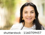 beautiful middle age hispanic... | Shutterstock . vector #1160709457