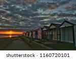 beach hut sunset. brightlingsea