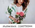 florist makes a bouquet. | Shutterstock . vector #1160750344