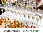 bartender pouring champagne or... | Shutterstock . vector #1160751934