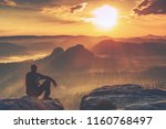 tired tourist sits on the edge... | Shutterstock . vector #1160768497