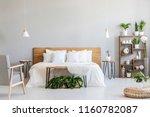 patterned armchair near white... | Shutterstock . vector #1160782087