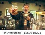 senior bearded man drinking... | Shutterstock . vector #1160810221
