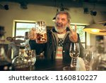 senior bearded man drinking...   Shutterstock . vector #1160810227