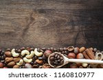 different nuts on a wooden... | Shutterstock . vector #1160810977