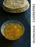 pancakes black rustic... | Shutterstock . vector #1160869081