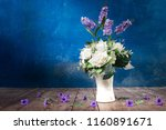 purple and white flowers in... | Shutterstock . vector #1160891671