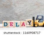 toy forklift hold letter block... | Shutterstock . vector #1160908717