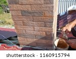 Installing House Chimney Block...