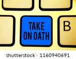 Small photo of Conceptual hand writing showing Take On Oath. Business photo text A solemn appeal to a deity Speak the truth Make a Promise Keyboard blue key Intention computer computing reflection document.