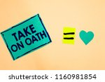 Small photo of Text sign showing Take On Oath. Conceptual photo A solemn appeal to a deity Speak the truth Make a Promise Turquoise piece paper reminder equal sign heart sending romantic feelings.