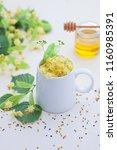cup of linden tea and linden... | Shutterstock . vector #1160985391