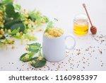 cup of linden tea and linden... | Shutterstock . vector #1160985397