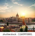 sun over parliament in budapest ... | Shutterstock . vector #1160993881