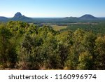 the glass house mountains of... | Shutterstock . vector #1160996974
