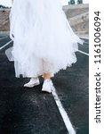 bride in white sneakers.... | Shutterstock . vector #1161006094