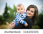 mother with her son in a park | Shutterstock . vector #116102101