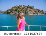 young woman standing on yacht...   Shutterstock . vector #1161027634