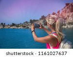 traveling woman take a photo...   Shutterstock . vector #1161027637