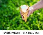 ice cream cone in hands | Shutterstock . vector #1161039451