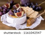 cheese brie camembert with figs ... | Shutterstock . vector #1161042547