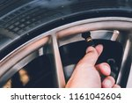 hand checking tire pressure. | Shutterstock . vector #1161042604