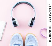 woman sneakers  headphones ... | Shutterstock . vector #1161070567