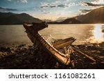 solitary boat wood destroyed... | Shutterstock . vector #1161082261