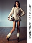 Young slim fashion japanese woman with ball. - stock photo