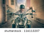 Man With Earbuds On Motorcycle