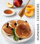 homemade morning pancakes peach ... | Shutterstock . vector #1161141181