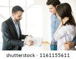 mid adult realtor showing... | Shutterstock . vector #1161155611