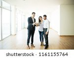 mid adult realtor explaining... | Shutterstock . vector #1161155764