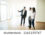 real estate agent showing new... | Shutterstock . vector #1161155767
