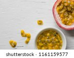 passion fruits on wooden... | Shutterstock . vector #1161159577