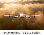 passenger plane in flight.... | Shutterstock . vector #1161168004