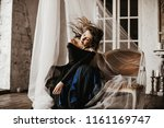 portrait of a girl in a long... | Shutterstock . vector #1161169747