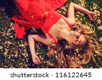 beautiful young woman lying on... | Shutterstock . vector #116122645