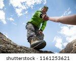 helping hand couple hikers in... | Shutterstock . vector #1161253621