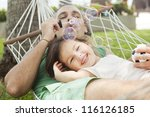 Dad And Daughter In A Hammock...