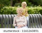 beautiful granny and her little ... | Shutterstock . vector #1161263851