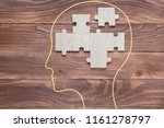 Stock photo head with jigsaw puzzle of abstract brain creative medical or business concept 1161278797
