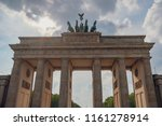 Small photo of Front view of Branderburger Tor - the famous historical monument in Berlin, Germany