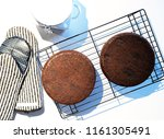 cooling chocolate cake layers | Shutterstock . vector #1161305491