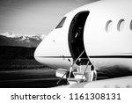 business jet with open door... | Shutterstock . vector #1161308131